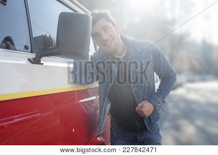 Vain Man Checking His Looks In The Mirror Of His Van