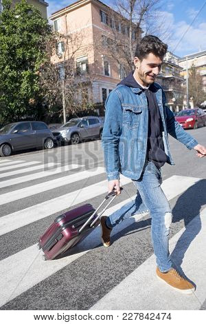 Man Coming To Town With A Small Luggage