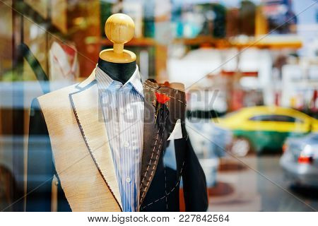 Male Suit On A Wooden Mannequin In The Shop Window. Concept Fashion, Design, Style