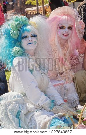 April, 19, 2014, Haarzuilens, The Netherlands: Beautifully Dressed Young Ladies With Wigs Of Pink An