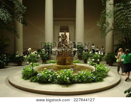 Fountain With Two Cupids In A Courtyard At The National Gallery Of Art, Washington, D.c. May 22nd, 2