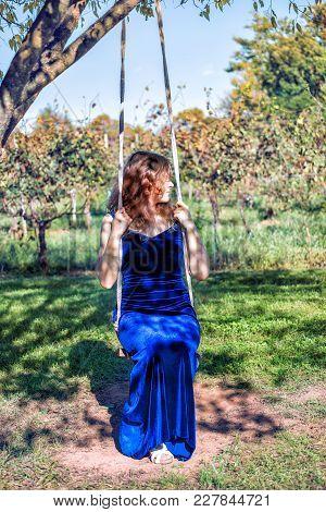 Elegant Young Woman In Blue Velvet Dress By Vineyard Winery Grapevine Leaves Green In Virginia Grape
