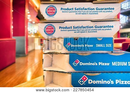 Bangkok, Thialand - February 18, 2017: Stack Of Take Out Boxes On A Table In Domino's Pizza Restaura