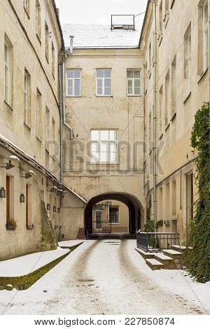 An Old Snowy Courtyard In Vilnius, Lithuania