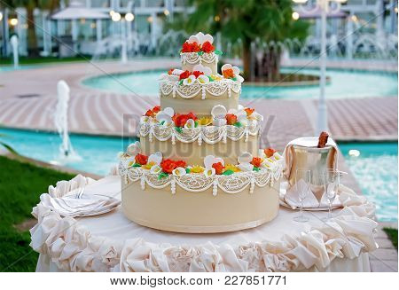 Wedding Cake With The Decoration And Pool View