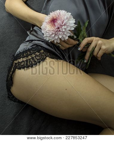 Photo Of The Girl In Satin Pyjamas With Flowers