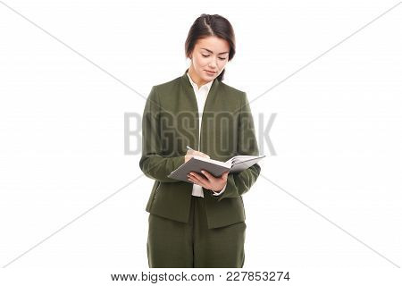 Portrait Of Young Manager Holding Personal Organizer On White Background