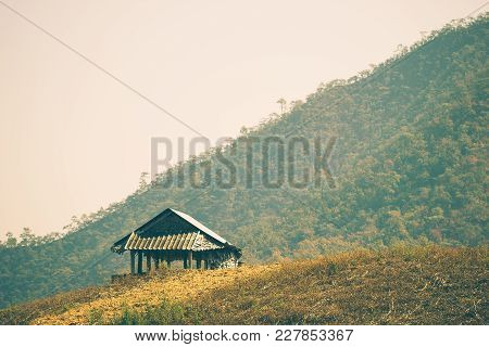 The Hut Among The Mountains Is Surrounded By Forests In Summer. The Concept Of Seclusion Is Truly Bl