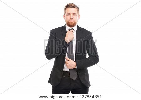 Portrait Of Young Businessman Wearing Suit, White Shirt And Necktie