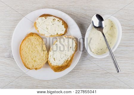 Sandwiches With Curd Cheese With Greens In White Plate, Curd Cheese In Box And Spoon On Wooden Table