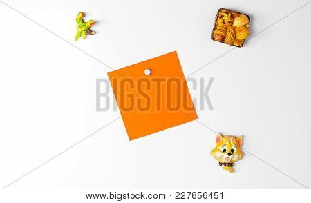 Orange Pure Blank White Sticker On The Fridge. Close Up.
