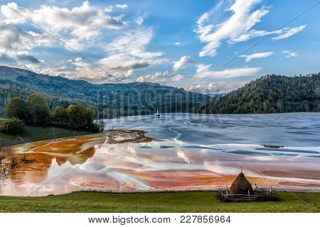 Colorful landscape of a flooded church in toxic polluted lake due to copper mining, Geamana Village,