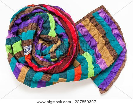 Rolled Stitched Patchwork Scarf From Silk Bands On White Background