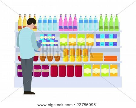 Man At Supermarket Making Choice, Male Looking At Products, Water In Bottles, Fresh Juice In Jars, V