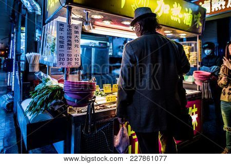 Man Standing For Buy Local Street Food From Food Stall