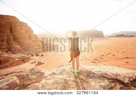 Person On A Top Of Mountains In A Desert. Sunset View. Nature. Tourist People Enjoy A Moment In A Na