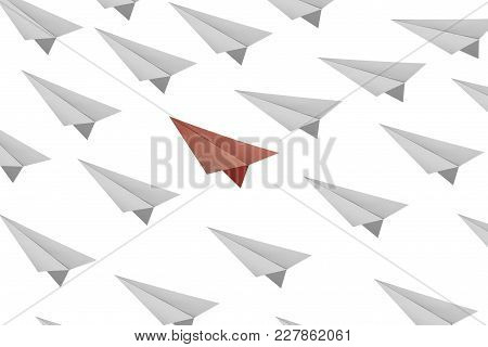 Business Concept As A Group Of Paper Plane  In One Direction And With One Individual Pointing In The
