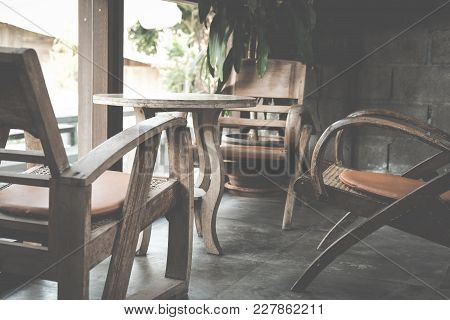 Round Wooden Table & Chair In Living Room On Mezzanine Near Window In House