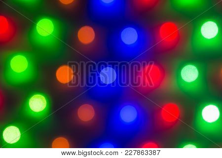 Abstract Image Of Defocused Varicolored Round Lights In A Row Closeup