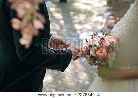 Wedding Ceremony Bride Groom Putting Golden Rings To Finger Of Each Other