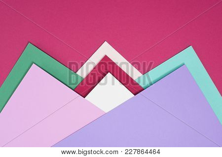 View Of Colorful Different Triangles Isolated On Burgundy