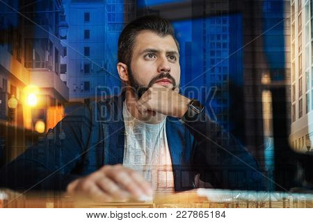 Curious Person. Clever Qualified Worker Of A Big Successful Company Sitting In Front Of A Modern Com