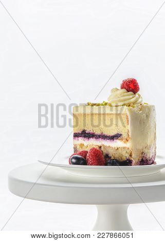 Piece Of Appetizing Cake On White Cake Stand Isolated On White