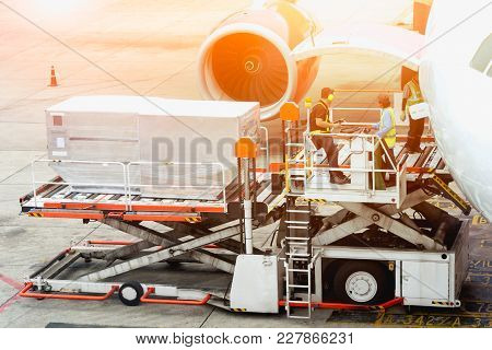 Air Freight Services Or Airplane Transportation, Operator Loading Cargo On Plane In Airport.