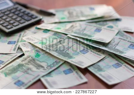 Money, Russian Banknotes In Denominations Of One Thousand Rubles Scattered On The Table