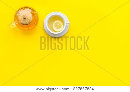 Tea With Lemon And Ginger On Yellow Background Top View.