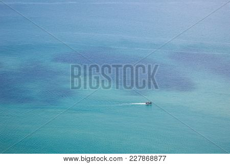 Photograph Of A Fisherman Boat Sailing In The Sea.