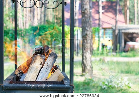 Grill and a house at the background