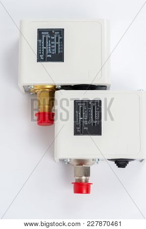 Close-up Two New Identical Pressure Switches In The Pipeline For Monitoring And Balancing The Pipeli