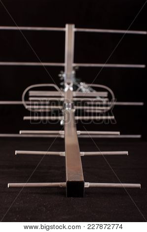 Yagi Uda Antenna For Uhf Tv Isolated On The Black Background