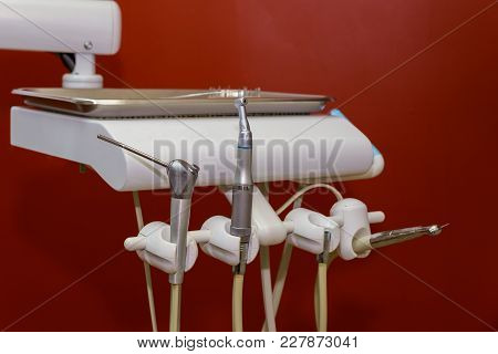 Metallic Dentist Tools Close Up On A Dentist Chair In Dentist Dental Clinic Interior Design