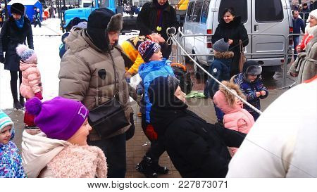 Kursk, Russia- 18 February, 2018: Russian Fun, The Children Run Under The Rope Game On Shrove Tuesda