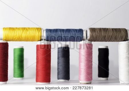 Set Of Colorful Sewing Threads On White Background.