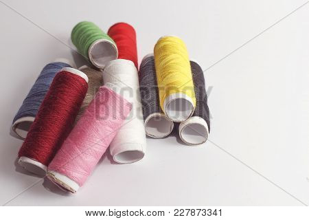 Accessories For Sewing Lie On A White Background. Multicolored Coils Of Threads
