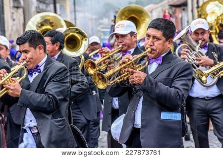 Antigua, Guatemala -  April 13, 2017: Musicians In Holy Thursday Procession In Colonial Town With Mo