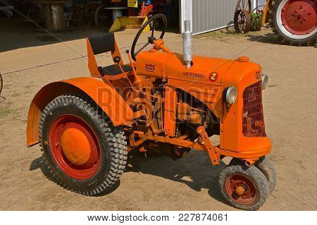 Rollag, Minnesota, Sept  2, 2017: A Small Old Restored Old Minneapolis Moline  Tractor Isdisplayed