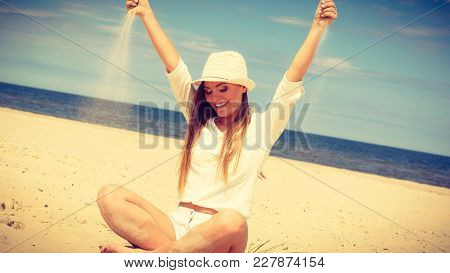 Happiness And Craziness. Smiling Crazy Girl Have Fun With Sand Outdoor. Young Attractive Long Haired