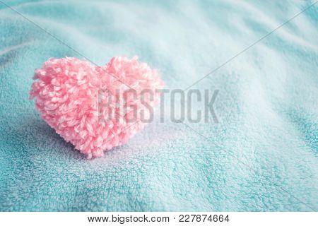 Fluffy Pink Thread Heart On Blue Soft Cozy Fabric Background. Handmade Pretty Heart. Love, Romance,