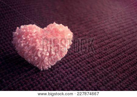 Fluffy Pink Thread Heart On Dark Knitted Burgundy Background. Handmade Pretty Heart. Love, Romance,