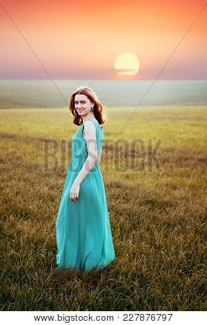 Girl Model In The Open Field At Sunset, Joy And Happiness From Unity With Nature