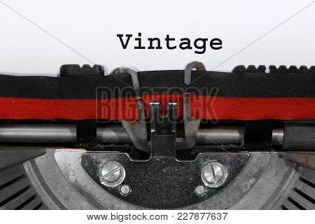 Text Vintage Written With The Typewriter On White Sheet