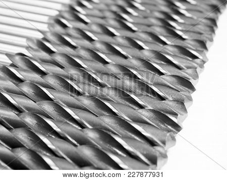 Many Drills Lie In A Row Tool Closeup Drilling Iron Many Sharp Shiny Spiral Steel Technology Industr