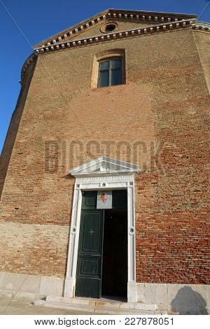 Chioggia, Ve, Italy - February 11, 2018: Door Of Old Church In Red Red Bricks Called Chiesa Di San D