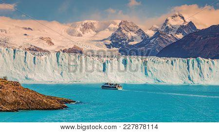 View Of Glacier Perito Moreno In Patagonia And Touristic Boat, South America, Autumn