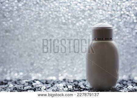 Blank White Cosmetic Bottle On Gray Background