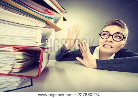 A Lot Of Work And Overwork Concept. Terrified Young Businesswoman Secretary With Huge Stack Of Binde